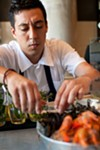 Executive chef Peter Villegas puts the finishing touches on an order from the raw bar.
