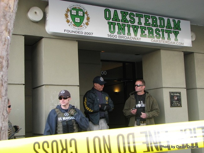 Federal agents stand guard at Oaksterdam April 2, 2012