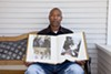 Gary King Sr. shows photographs of his son, Gary Jr., who was fatally shot by Oakland police Sergeant Patrick Gonzales.