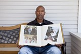 JORGE RIVAS/COLORLINES.COM - Gary King Sr. shows photographs of his son, Gary Jr., who was fatally shot by Oakland police Sergeant Patrick Gonzales.