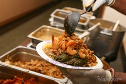 Heaping combination plates are A Taste of Africa's stock in trade. - TASIN SABIR