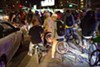Hundreds of cyclists take to the streets in Oakland during the monthly East Bay Bike Party.