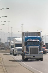 PHOTOGRAPH BY CHRIS DUFFEY - Idling trucks spew diesel soot into the West Oakland air.