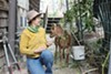 Jeannie McKenzie and one of her goats.