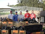 Jeff Humphrey (far right) and his son Jack (next to him) round up used baseball gear for kids in need.
