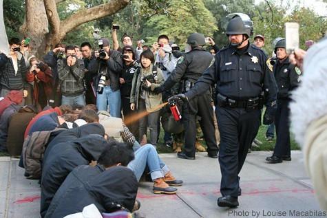 John Pike sprays UC Davis protesters.
