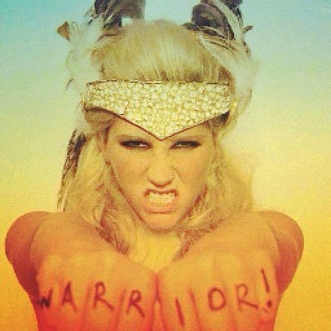 Ke$ha wearing a headdress made of teeth.