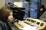 NICK BELLIZZI - Lanaya Lewis works the board at Youth Radio.
