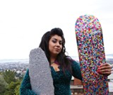 "Leanne ""Elrod"" Rodriguez shows off some of her bedazzled skateboards."