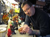 """JEREMY BRAUTMAN - Leecifer earned the moniker """"toy ruiner"""" for painting over other people's toys. His first original toy is Honoothe Flame (right)."""