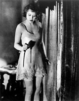 London shopgirl Alice (German actress Anny Ondra) wields a knife in Alfred Hitchcock's 1929 film Blackmail.