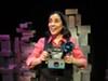 Marga Gomez as Polaroid Phillie in her latest solo show.