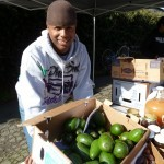 Market manager Toveo Hill sells some avocados.