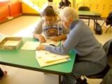 JOCELYN WIENER - Mary Ann Benson tutors student Erika Muñoz.