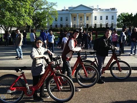 Nichols and his sons using the bike-sharing program in Washington, DC. - COURTESY OF MATT NICHOLS