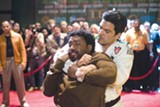 Mike Terry (Chiwetel Ejiofor) takes a beating from the Brazilian (John Machado) in Redbelt.