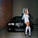 ARTURO TORRES - Nanda dresses like a Harajuku doll by way of East LA, and raps like a slower Nicki Minaj.