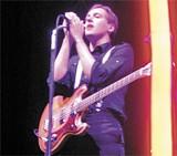 NATE SELTENRICH - Neon preacher: Win Butler of Arcade Fire.