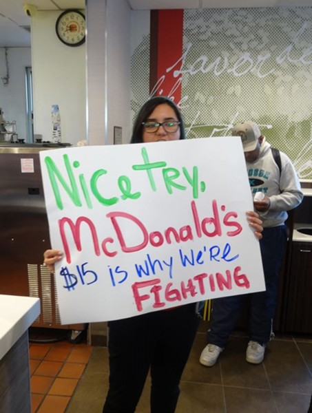 A fast food worker responds to McDonald's wage increase announcement at a rally on April 2. - DARWIN BONDGRAHAM