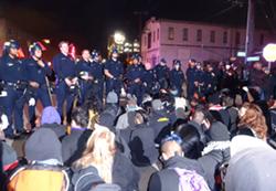 Oakland police enforce a nighttime ban on street marches by detaining dozens of demonstrators. - DARWIN BONDGRAHAM