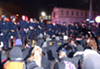 Oakland police enforce a nighttime ban on street marches by detaining dozens of demonstrators.
