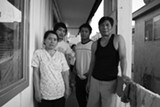 MOMO CHANG - Oo Meh, April Ni, Bo Reh, and Groto Ni stand in the breezeway of the apartment complex they share with other recent Burmese refugees. Oo Meh and Groto Ni were Karenni rice farmers who spent more than 20 years in a Thai refrefugee camp before arriving in Oakland just months ago.