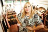 Owner Sarah Dunbar carefullly curates the vintage clothes at Pretty Penny.