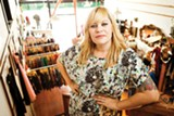 STEPHEN LOEWINSOHN - Owner Sarah Dunbar carefullly curates the vintage clothes at Pretty Penny.