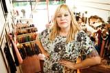 STEPHEN LOEWINSOHN - Owner Sarah Dunbar carefullly curates the vintage clothes at Pretty Penny.