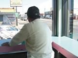 JOCELYN WIENER - Pedro Reyes overlooks the street corner where he was mugged recently.