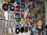 DAMON BEEBE - Pirates Press founder Eric Mueller and a sampling of the vinyl offered by his company.