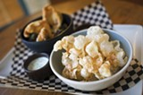 """CHRIS DUFFEY - Plum Bar's """"fried stuff"""" dish features pigs' ears, chicken skin, and more."""
