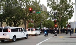 Police surround demonstrators on Broadway in Oakland — before dark — last evening. - AL OSORIO