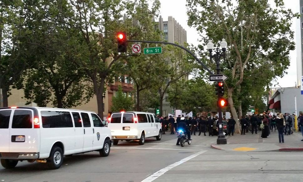 Police surround demonstrators on Broadway in Oakland — before dark — last evening. - AL OSORIO