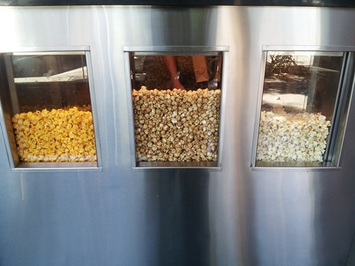 Popcorn is scooped to order, just like at a movie theater concession stand.