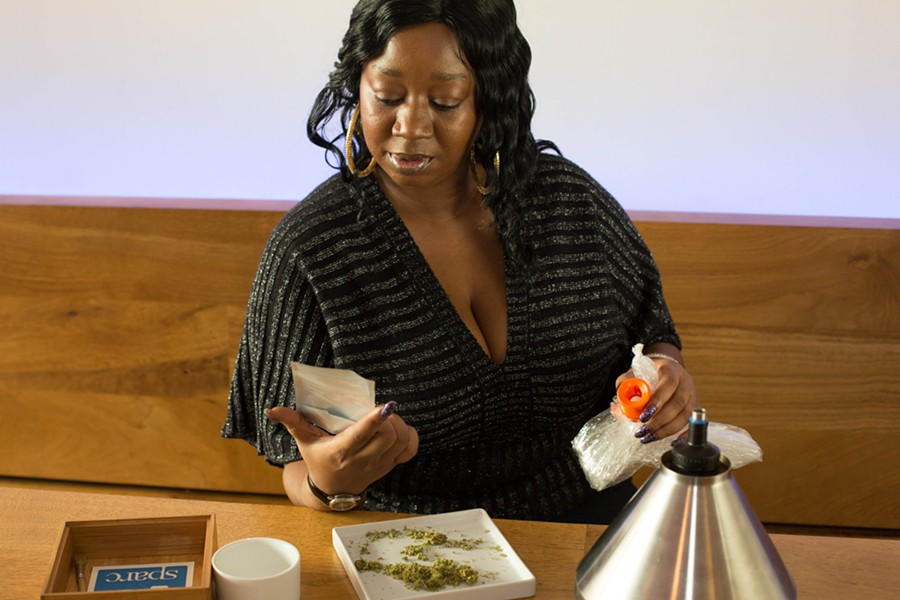 A California medical cannabis patient uses a vaporizer at an on-site medication area in a San Francisco dispensary. - DRUG POLICY ALLIANCE