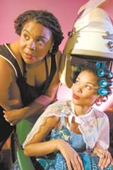 Queenie Pie (Amanda King) and customer (Sarita Cannon).