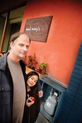 CHRIS DUFFEY - Restaurant owner Jack Stewart and his daughter Song-An in front of their hard-won gas meter.