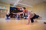 CHRIS DUFFEY - Robert Mooring says instructors get paid $10-$16 per head in a class at Piedmont Yoga.