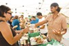 Sample locally grown food at the popular farmers' market.