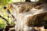STEPHEN LOEWINSOHN - Santiago Portilla climbs Mortar Rock in the North Berkeley hills.