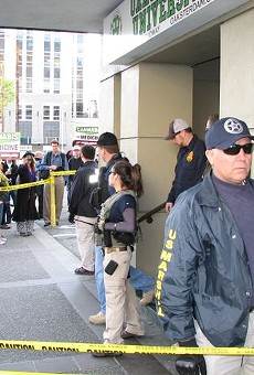 Shortly after the raid, a group of protesters gathered outside Oaksterdam to show their support.