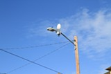 ALI WINSTON - ShotSpotter's technology involves setting up microphones on lampposts and utility poles.