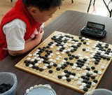 MING LIAO - Six-year-old Austen Liao considers a move.