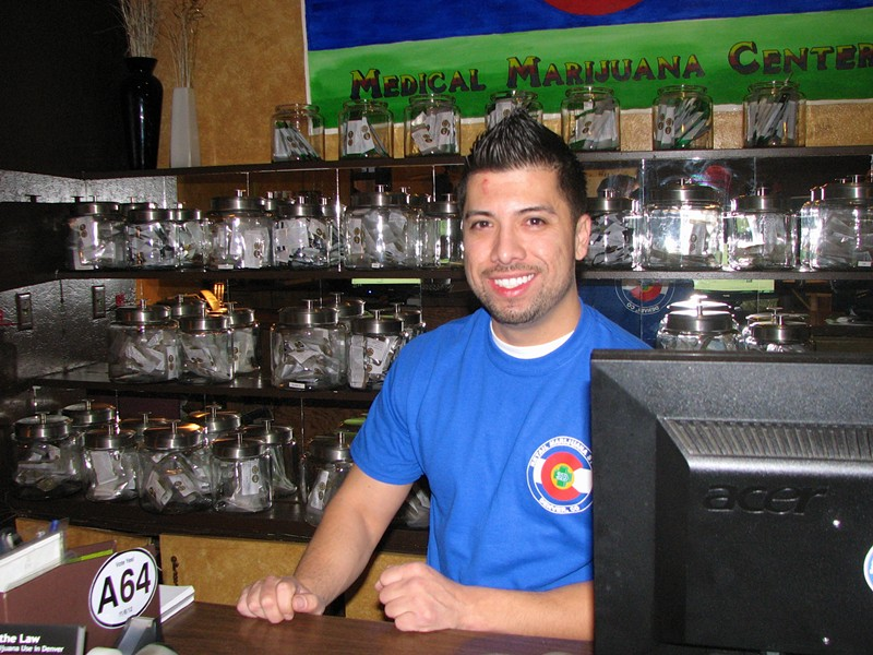 3D Cannabis Center budtender, Denver, Colorado., January 1, 2014. - DAVID DOWNS