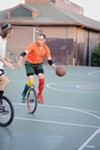 Sowers attempts to manuever his unicycle past a defender.