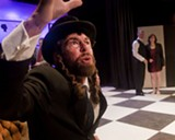 Stanley Spenger plays a drunk and philosophizing rabbi.
