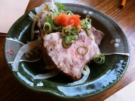 Star dish: beef tataki, cold slices of shin with vinegared onions.