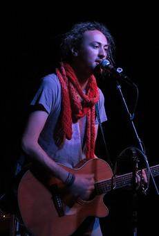 Strickman performing at La Peña.