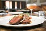 BERT JOHNSON - The bacon chop, cut from a whole Mangalitsa hog, made for a decadently fatty entrée.